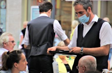 Server wearing mask during Covid-19 pandemic
